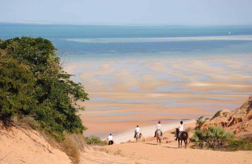 Riding horses down the beach, Mozambique