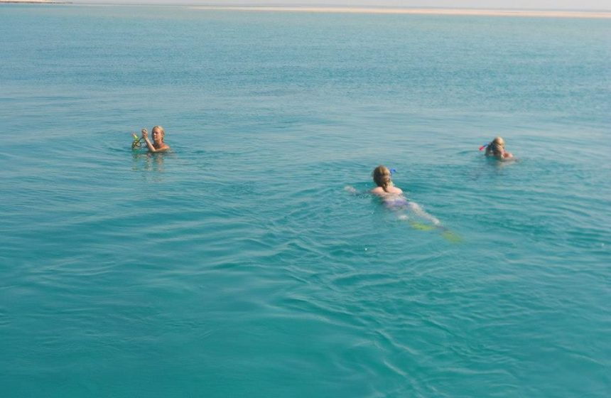 Swimming in blue water, Mozambique Safari