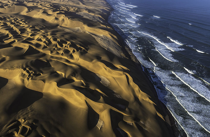 Sand dunes by the ocean, Namibia