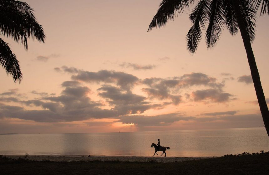 Horseback riding at Dusk, Mozambique